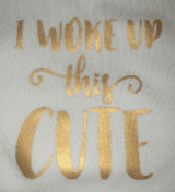 White baby  bib in gold font (  I woke up this cute )